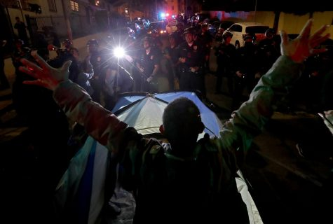 Homeless man sets up tent in front of LAPD. (Los Angeles Times)